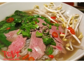 Pho Tai - Beef noodle soup with rare beef slices.